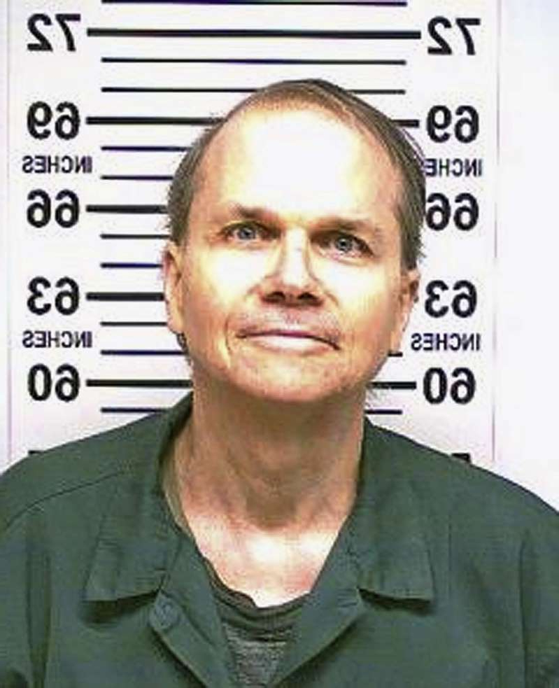 "FILE -  This Jan. 31, 2018 photo, provided by the New York State Department of Corrections, shows Mark David Chapman, the man who killed John Lennon outside his Manhattan apartment in 1980. Chapman said he was seeking glory and deserved the death penalty for the ""despicable"" act. Chapman made the comments in response to questions last month from a parole board, which denied him parole for an 11th time. (New York State Department of Corrections via AP, File)"