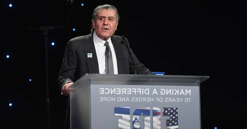 Haim Saban wearing a suit and tie: Haim Saban speaks onstage at Friends of The Israel Defense Forces (FIDF) Western Region Gala at The Beverly Hilton Hotel on November 1, 2018 in Beverly Hills, California.