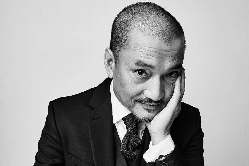 Jon Jon Briones wearing a suit and tie: Storm Santos