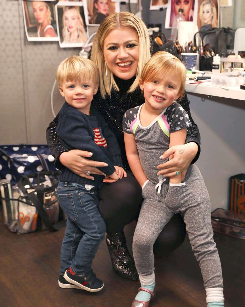 Kelly Clarkson et al. posing for the camera: Kelly Clarkson/Instagram Kelly Clarkson with daughter River (L) and son Remy in 2018