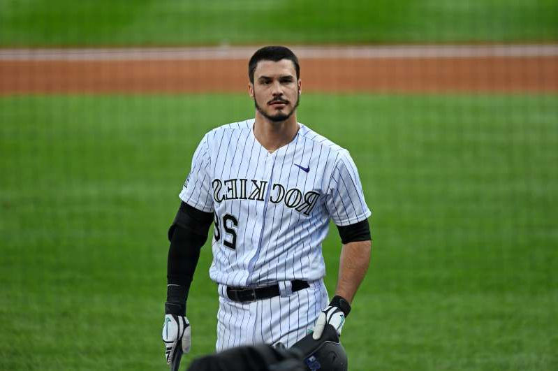 Nolan Arenado standing on a baseball field: The Rockies announced that they've placed third baseman Nolan Arenado on the 10-day injured list with left AC joint inflammation and a left shoulder bone bruise.