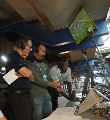 Slide 1 of 13: The WJR-AM broadcast team of Dan Miller (right), spotter Joe Abramson (center) and Lomas Brown broadcast action of the Detroit Lions game against the Green Bay Packers from Ford Field Sunday, Sept. 20, 2020.