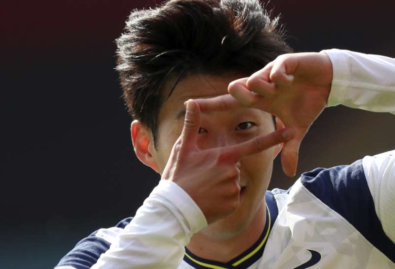 Tottenham's Son Heung-min celebrates after scoring his side's second goal during the English Premier League soccer match between Southampton and Tottenham Hotspur at St. Mary's Stadium in Southampton, England, Sunday, Sept. 20, 2020. (Cath Ivill/Pool via AP)