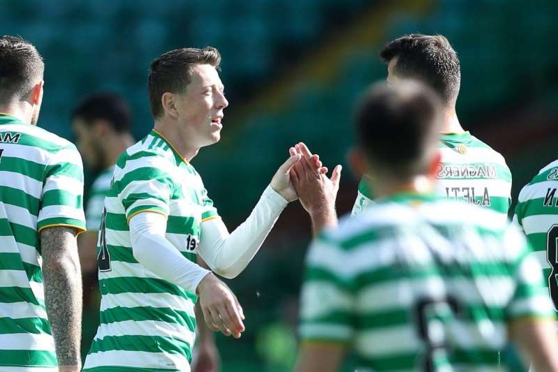 a person standing in front of a crowd: Celtic v Livingston - Ladbrokes Scottish Premiership