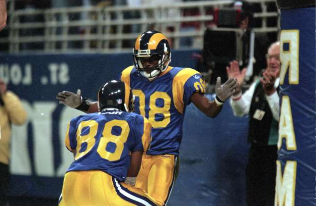 Slide 19 of 33: The Rams have deployed a few strong receiver tandems, but Isaac Bruce and Torry Holt were irreplaceable in lifting the Rams to their first Super Bowl title and triggering Kurt Warner's stunning ascent. That duo stayed productive after Warner's exit. Holt's 12,594 yards in the 2000s led the NFL, while Bruce's 15,208 for his career rank fifth all time. Az Hakim's presence during the