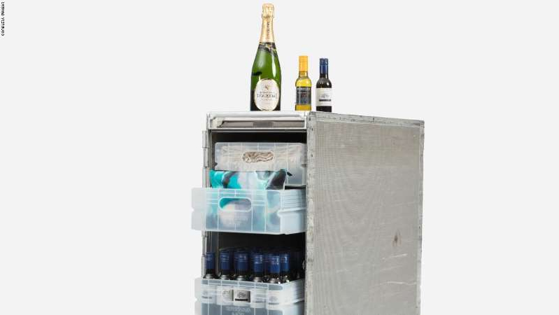 a bottle next to a refrigerator: Aviation fans rushed to snap up these Qantas catering carts.