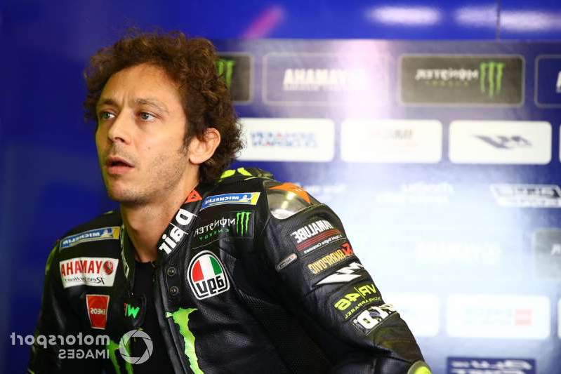 a close up of Valentino Rossi: Valentino Rossi, Yamaha Factory Racing
