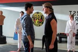 a group of people standing in a room: Cobra Kai