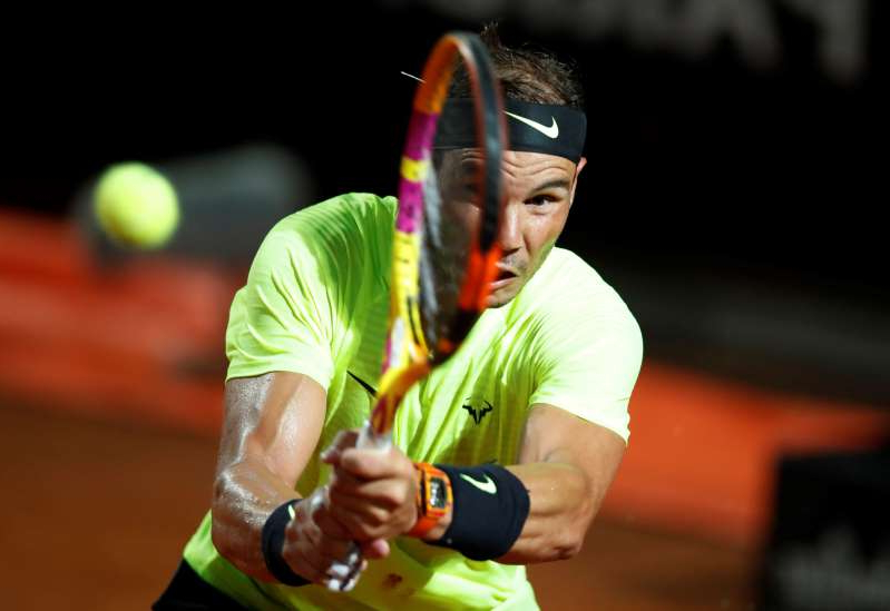 a man hitting a ball with a racket: ATP Masters 1000 - Italian Open