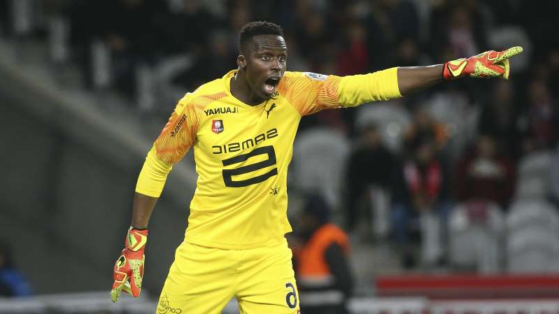a man holding a baseball bat: Chelsea have signed goalkeeper Edouard Mendy