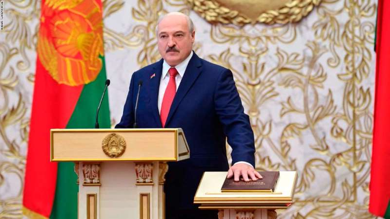 Alexander Lukashenko wearing a suit and tie: Belarusian President Alexander Lukashenko takes his oath of office during his inauguration ceremony at the Palace of the Independence in Minsk, Belarus, Wednesday, Sept. 23, 2020. Lukashenko of Belarus has assumed his sixth term of office in an inauguration ceremony that wasn't announced in advance. State news agency BelTA reports that the ceremony will take place with several hundred top government official present. (Andrei Stasevich/Pool Photo via AP)
