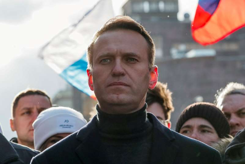 Alexei Navalny standing in front of a crowd: FILE PHOTO: Russian opposition politician Alexei Navalny takes part in a rally to mark the 5th anniversary of opposition politician Boris Nemtsov's murder and to protest against proposed amendments to the country's constitution, in Moscow