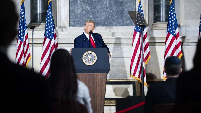 Donald Trump et al. wearing costumes: President Trump speaks during a White House Conference on American History at the National Archives on September 17.