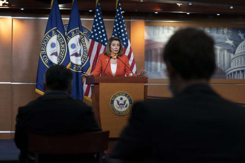 Nancy Pelosi et al. in a room: U.S. House Speaker Nancy Pelosi, a Democrat from California, speaks during a news conference at the U.S. Capitol in Washington, D.C., U.S., on Thursday, Sept. 24, 2020. Pelosi expressed hope that there would be another round of stimulus talks, but gave no indication that Democrats would bend on their stance that the country needs $2.2 trillion in fresh aid.