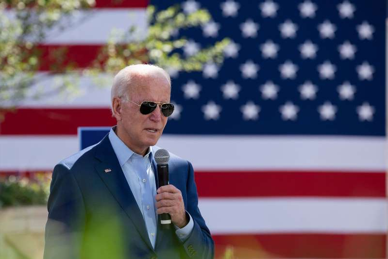 a man wearing a suit and tie: Joe Biden speaks in Charlotte, North Carolina, on Sept. 23.