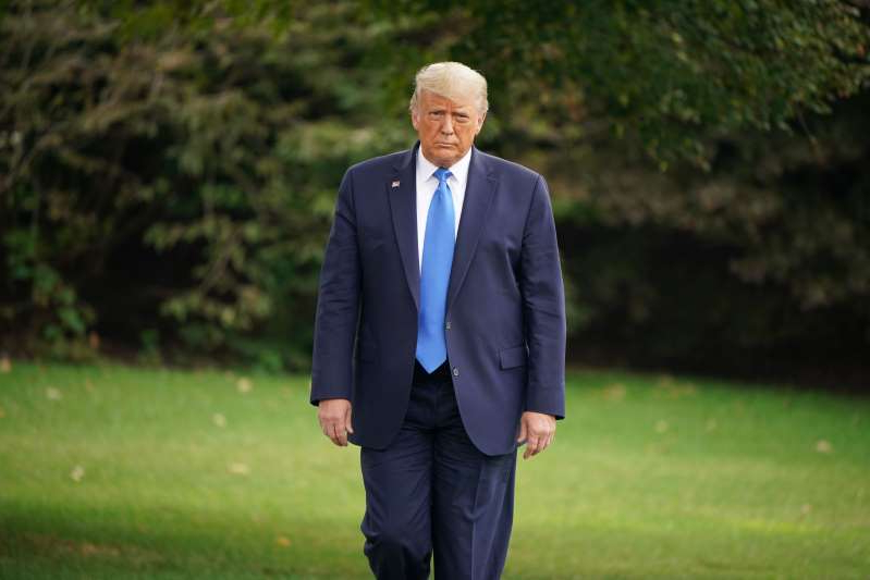 Donald Trump wearing a suit and tie: President Donald Trump is closing the gap against Democratic presidential candidate Joe Biden, according to a poll released Thursday.
