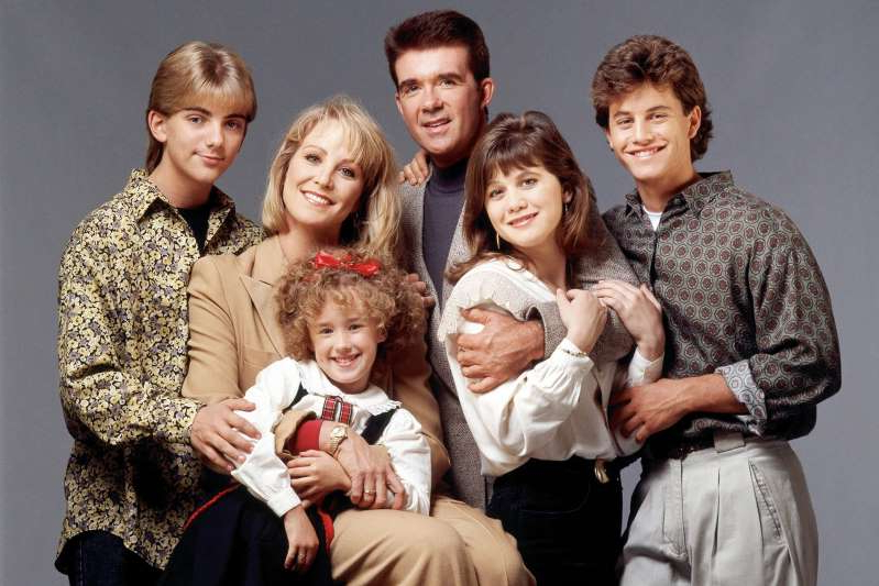 Kirk Cameron, Tracey Gold, Alan Thicke, Joanna Kerns, Jeremy Miller posing for the camera: Walt Disney Television via Getty