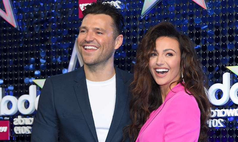 Michelle Keegan, Mark Wright are posing for a picture: Hello! Magazine
