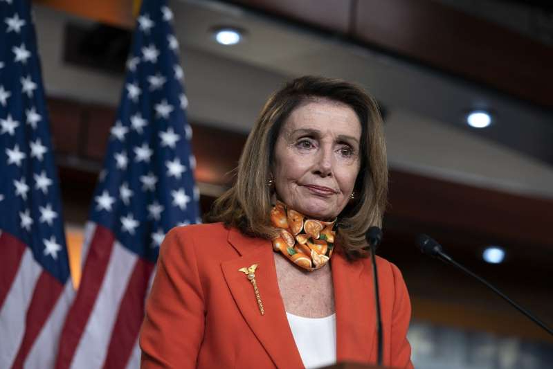 Nancy Pelosi wearing a neck tie: House Speaker Pelosi Holds Weekly News Conference