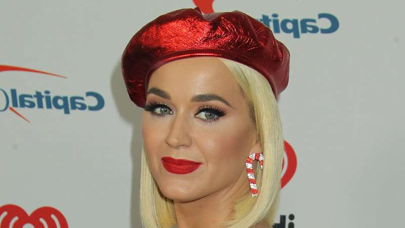 a close up of Katy Perry wearing a hat