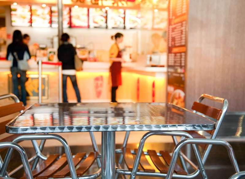 a dining table in a restaurant: fast food interior