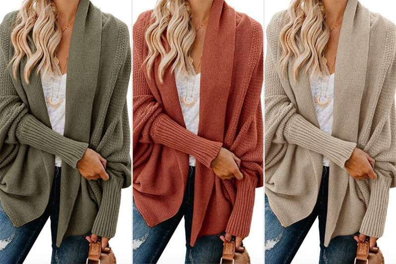 a group of people standing next to a woman: amazon oversized cardigan