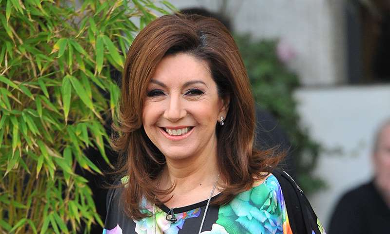 Jane McDonald smiling for the camera: Hello! Magazine