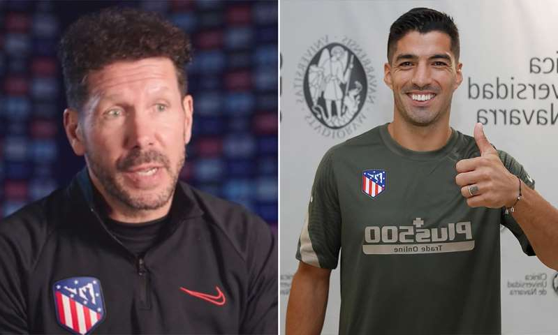 Luis Suarez, Diego Simeone are posing for a picture: MailOnline logo