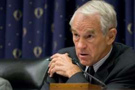 Ron Paul sitting at a desk: Ron Paul hospitalized in Texas