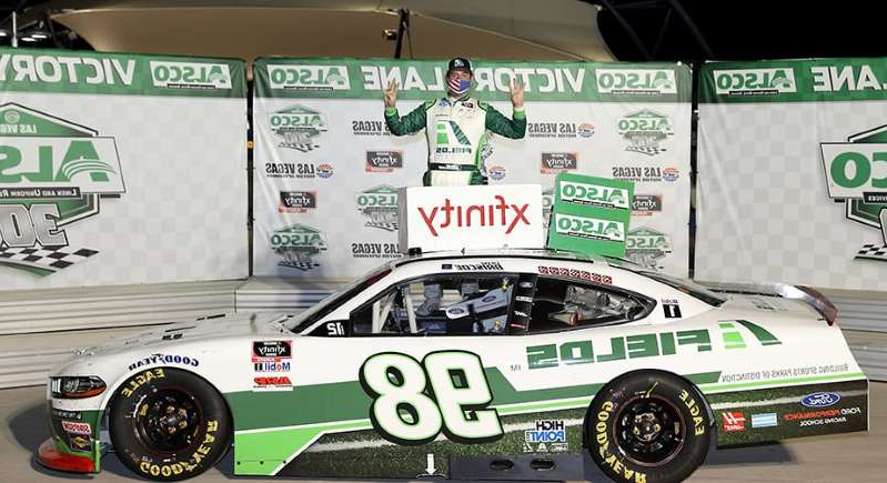a close up of a green car on display: Eight is enough: Chase Briscoe reaches win goal in Xfinity Series Playoffs opener in Vegas