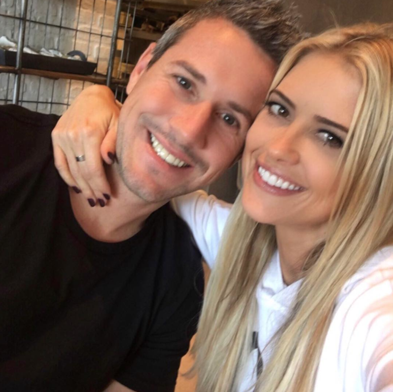 a couple of people posing for the camera: Christina Anstead and Ant Anstead