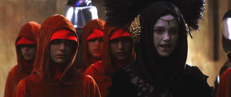 a couple of people that are looking at the camera: Keira Knightley Sabe Star Wars: The Phantom Menace