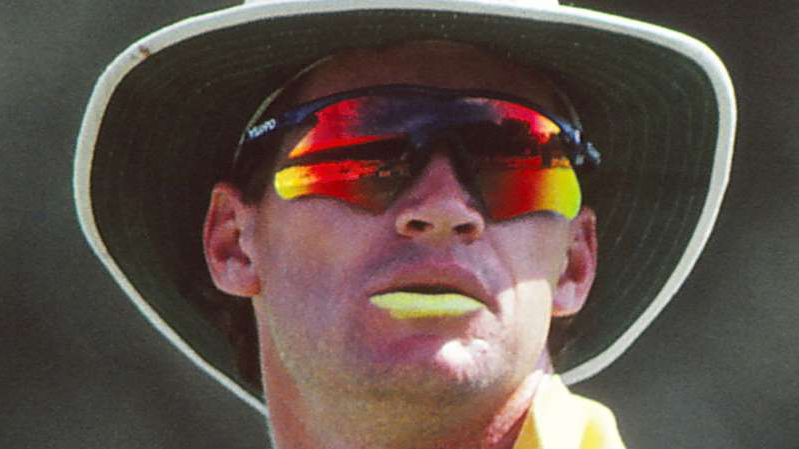 a person making a face for the camera: Dean Jones wearing sunglasses for Australian during a 1992 ODI match.