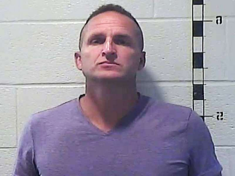 a person posing for the camera: Former Louisville Metro Police Officer Brett Hankison is pictured in a booking photo released by the Shelby County Detention Center in Kentucky on Sept. 23, 2020.