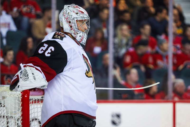 a person standing in front of a crowd: Darcy Kuemper may be a cap casualty for the Coyotes this offseason, as the team is desperately in need of room to maneuver under the cap ceiling.