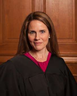 a woman smiling for the camera: Amy Coney Barrett is a conservative jurist with both academic and appeals court credentials [File: Rachel Malehorn/Wikipedia]