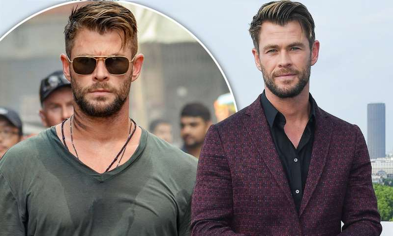 Chris Hemsworth wearing glasses and looking at the camera: MailOnline logo