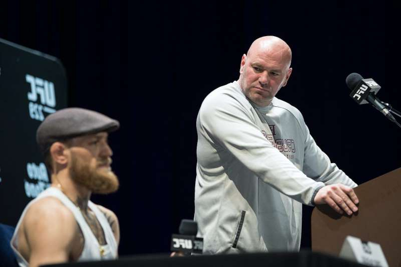 Dana White holding a microphone: Dana White is angry at Conor McGregor. Photo by Chris Unger / Zuffa LLC via Getty Images