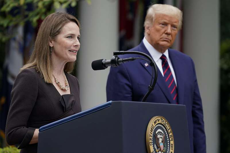 Donald Trump wearing a suit and tie: Judge Amy Coney Barrett speaks after President Donald Trump announced Barrett as his nominee to the Supreme Court on Saturday in the Rose Garden.