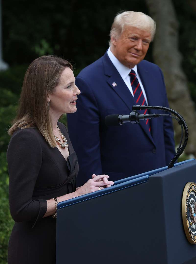 Donald Trump wearing a suit and tie: President Donald Trump nominates federal appeals court Judge Amy Coney Barrett of Indiana to the Supreme Court on Sept. 26, 2020.