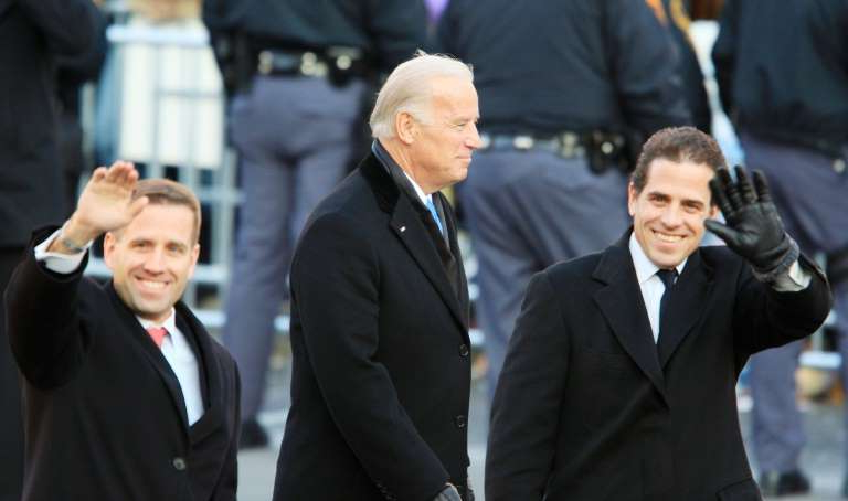 Hunter Biden, Joe Biden, Beau Biden are posing for a picture: Vice president Joe Biden with his sons Hunter (L) and Beau (R) during the 2009 inaugural parade of president Barack Obama