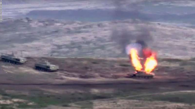 smoke coming out of the water: A photo released by the Armenian defense ministry appears to show an Azerbaijani tank being destroyed on September 27, 2020.