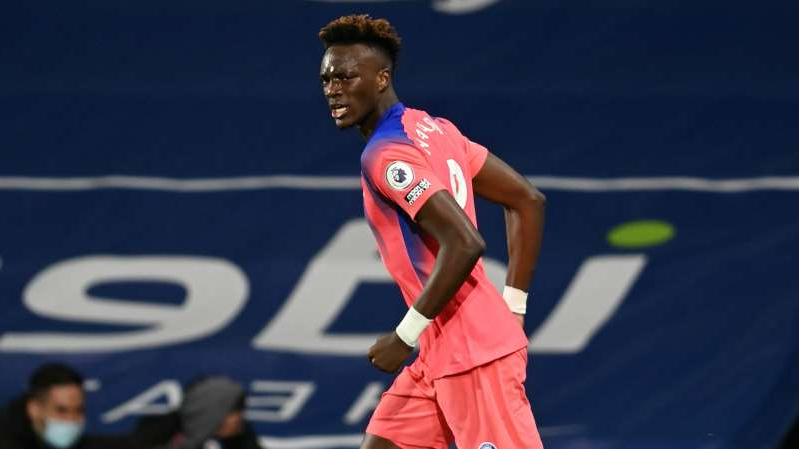 Tammy Abraham holding a racket on a court: Chelsea striker Tammy Abraham