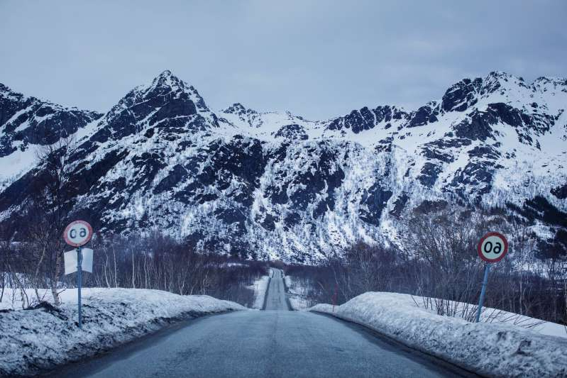 a close up of a snow covered mountain: A snowy road in Lofoten, Norway; Kyrre Lien and Per Christian Selmer-Anderssen drove more than 8,000km on their journey through Europe [Kyrre Lien/Al Jazeera]
