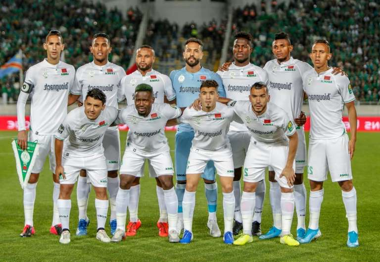 a group of football players posing for a picture: Raja Casablanca hold a two-point league lead in Morocco with four rounds remaining.