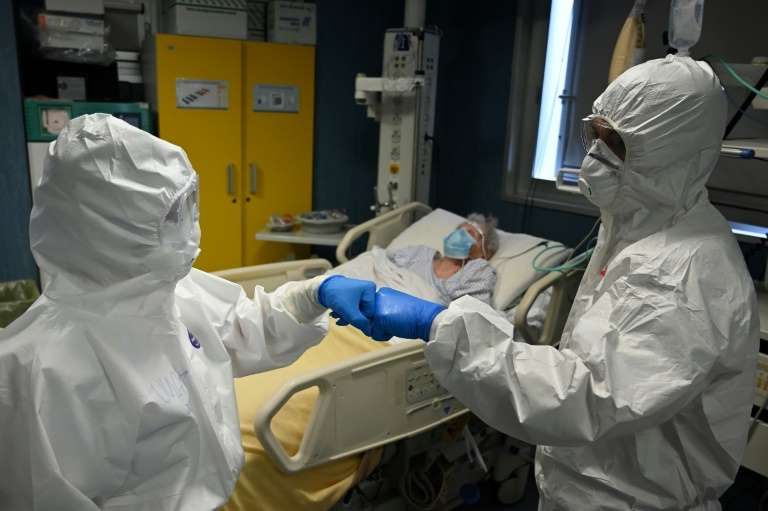 a group of people in a room: Italy was hit hard early on by the virus but has since brought its infection rates under control