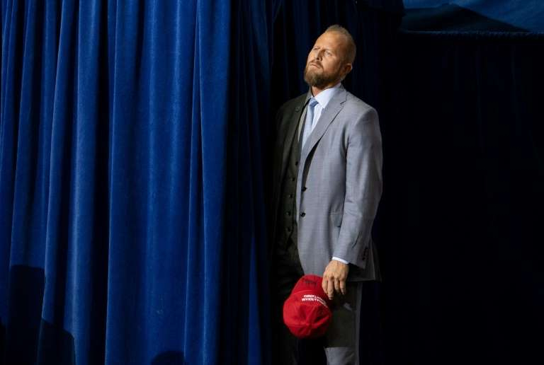 a man wearing a suit and tie standing in front of a curtain: Parscale was replaced as Trump's campaign manager in July