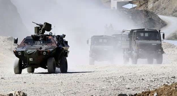 a truck driving down a dirt road: Turkish troops patrol in Hakkari province, southeastern Turkey in June 2010 where Turkish troops and Kurdish fighters clashed.