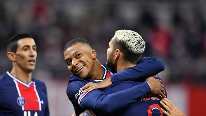 Angel Di Maria standing in front of a crowd: Mauro Icardi celebrates with Kylian Mbappe after scoring for PSG