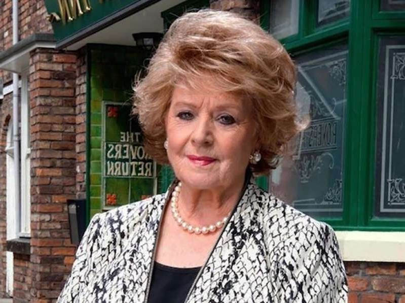 Barbara Knox standing in front of a building